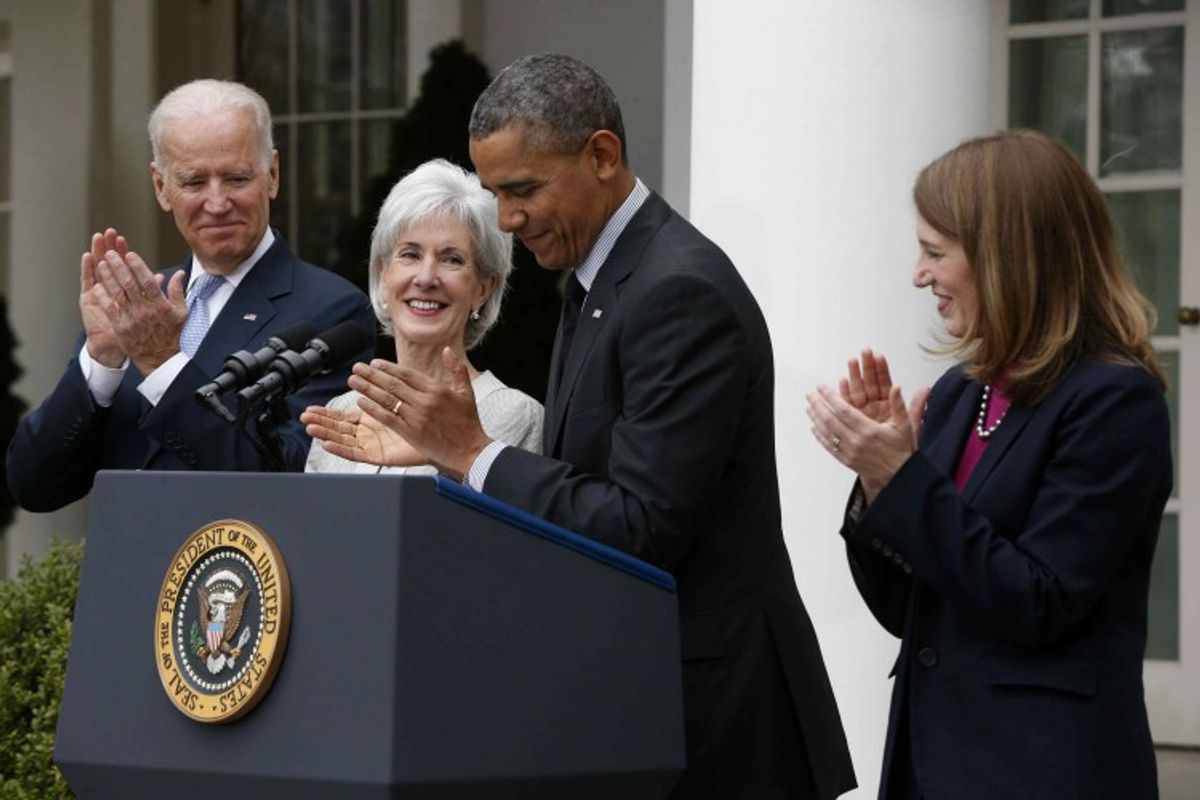 President Barack Obama and Vice President Joe Biden stand with outgoing Health and Human Services Secretary Kathleen Sebelius, second from left, and his nominee to be her replacement, Budget Director Sylvia Mathews Burwell, Friday, April 11, 2014, in the Rose Garden of the White House in Washington. The moves come just over a week after sign-ups closed for the first year of insurance coverage under the so-called Obamacare law.  (AP Photo/Charles Dharapak)
