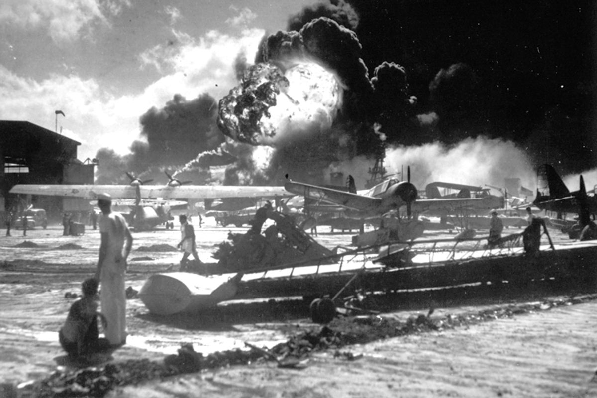Sailors watch the explosion of the USS Shaw in the background, during the Japanese attack on Pearl Harbor, Hawaii, Dec. 7, 1941.    (AP)