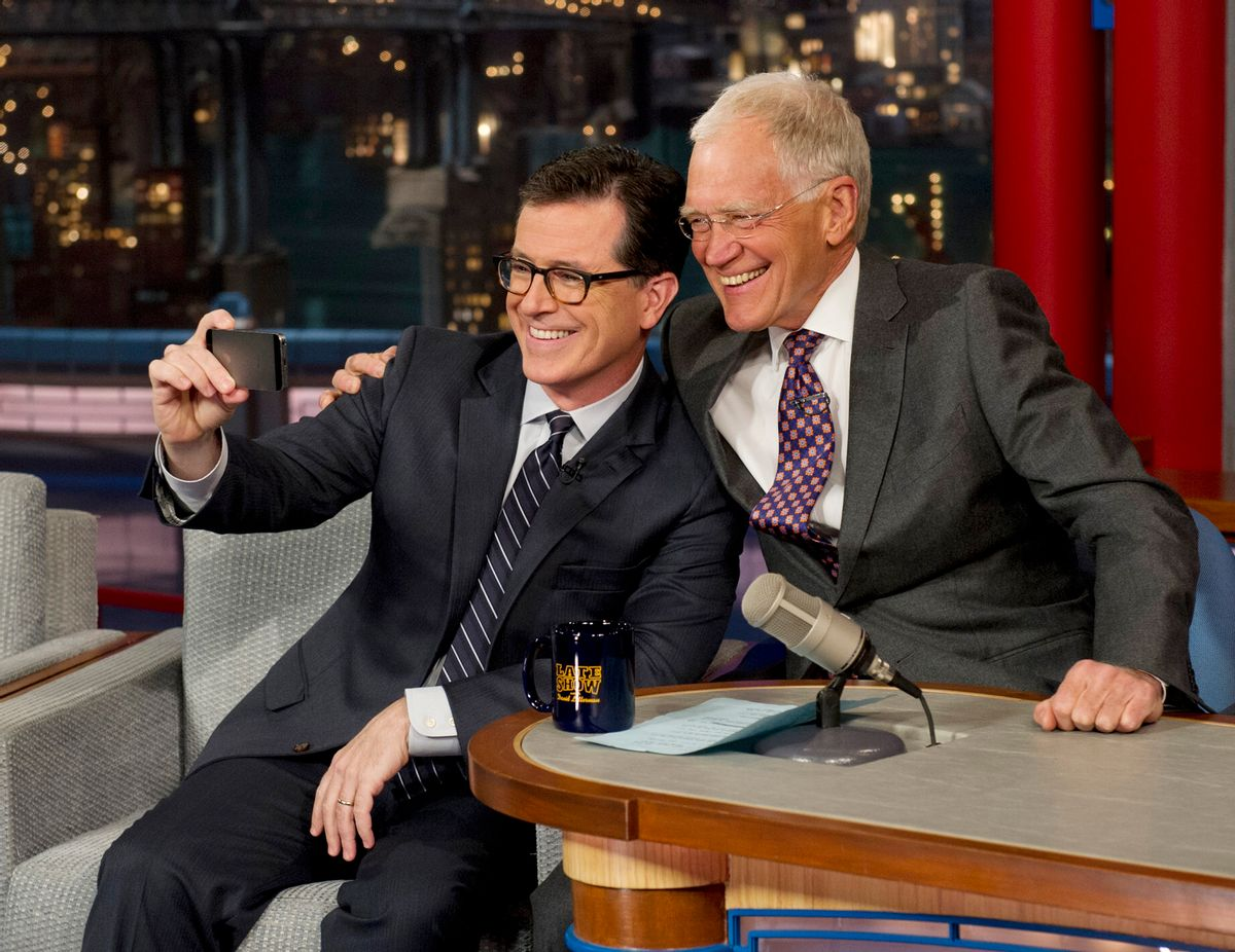 """In this photo provided by CBS, Comedy Central's Stephen Colbert, left, takes a """"selfie"""" with host David Letterman on the set of the """"Late Show with David Letterman,"""" Tuesday, April 22, 2014 in New York. This was Colbert's first visit to the show since CBS announced that he will succeed Letterman as host when he retires in 2015. (AP Photo/Jeffrey R. Staab) MANDATORY CREDIT, NO SALES, NO ARCHIVE, FOR NORTH AMERICAN USE ONLY     (AP)"""