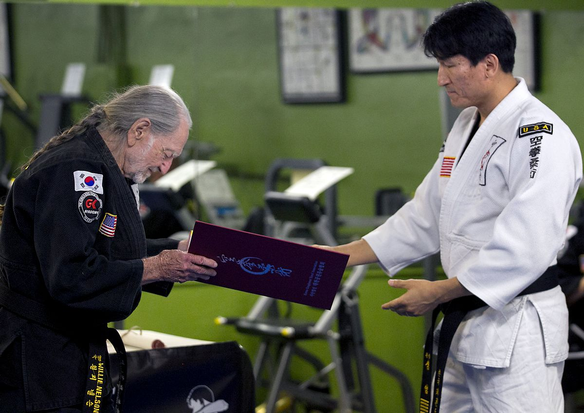 Willie Nelson, the country music icon who turns 81 this week, bows as he receives his fifth-degree black belt in the martial art of Gong Kwon Yu Sul on Monday, April 28, 2014, in Austin, Texas.  (AP Photo/Austin American-Statesman, Ralph Barrera)  AUSTIN CHRONICLE OUT, COMMUNITY IMPACT OUT, INTERNET AND TV MUST CREDIT PHOTOGRAPHER AND STATESMAN.COM, MAGS OUT (AP)