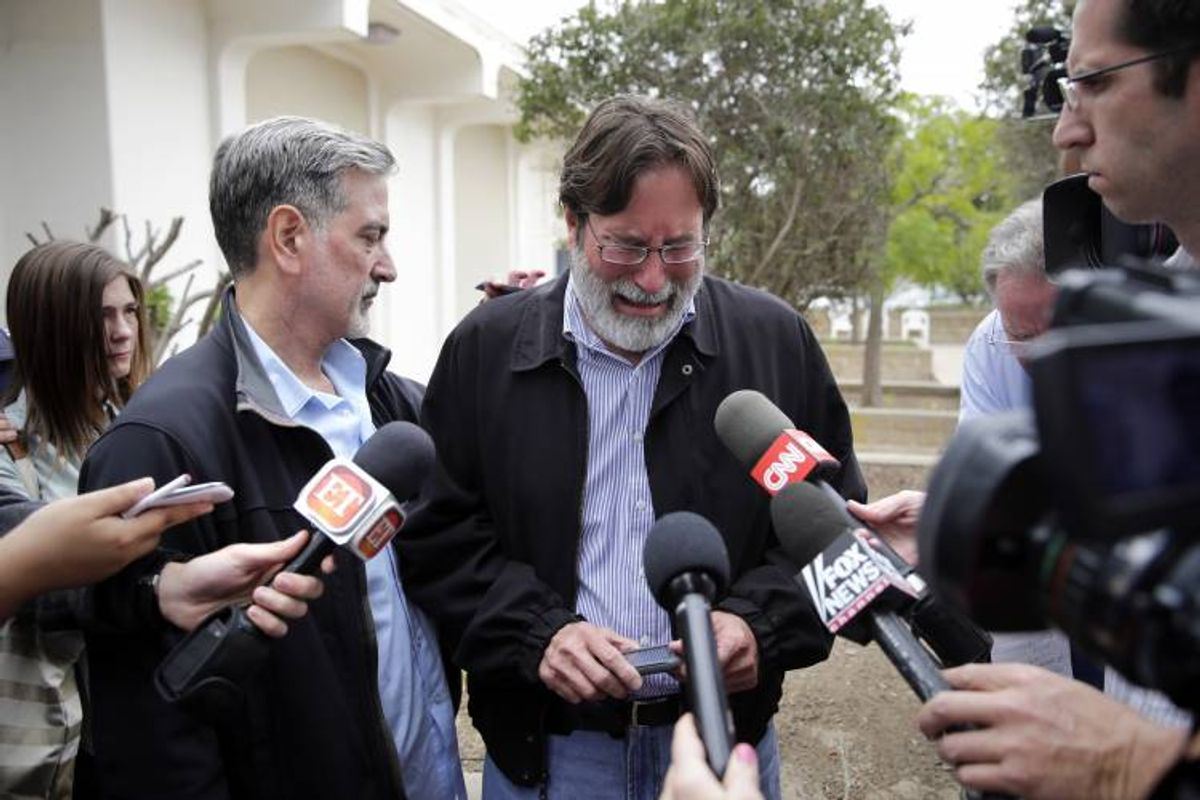 Richard Martinez, center, who says his son Christopher Martinez was killed in Friday night's mass shooting that took place in Isla Vista, Calif. (AP Photo/Jae C. Hong)        (AP)