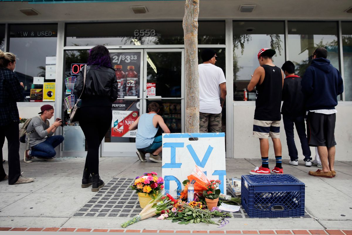 Some flowers are left in front of IV Deli Mart, where part of Friday night's mass shooting took place by a drive-by shooter, on Saturday, May 24, 2014, in Isla Vista, Calif. Alan Shifman, a lawyer who represents Hollywood director Peter Rodger, says the family believes Rodger's son, Elliot Rodger, was the lone gunman who went on the shooting rampage near the University of California at Santa Barbara.   ((AP Photo/Jae C. Hong))