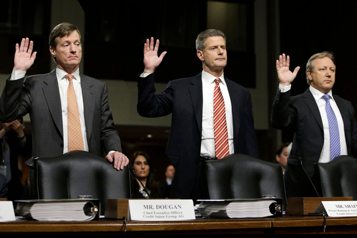 Credit Suisse officials CEO Brady Dougan, Robert Shafir and Hans Urlich-Mesiter are sworn in before the Senate Homeland and Governmental Affairs Investigations Subcommittee, February 26, 2014.       (Reuters/Gary Cameron)