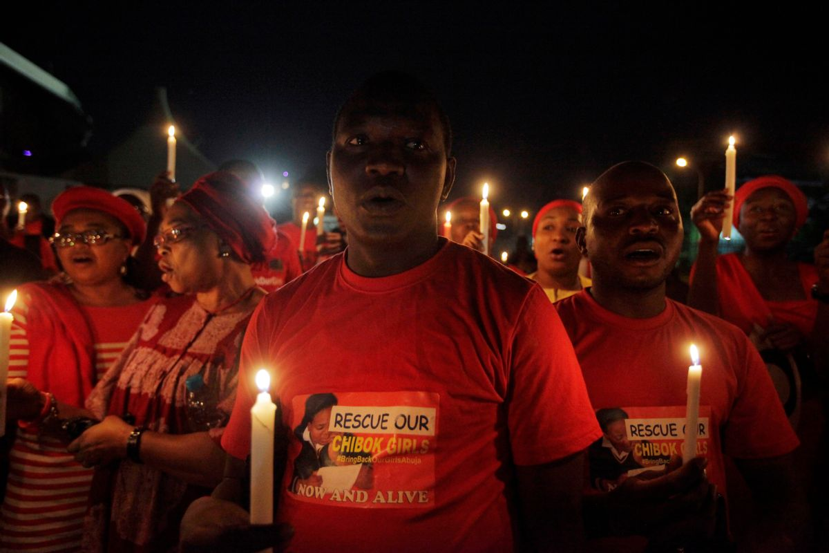 """Men and Women hold candle light  during a vigil to mark thirty days since the girls of Government secondary school Chibok  were Kidnapped in Abuja, Nigeria, Wednesday, May 14, 2014. Nigeria's government is ruling out an exchange of more than 270 kidnapped schoolgirls for detained Islamic militants, Britain's top official for Africa said Wednesday. President Goodluck Jonathan has """"made it very clear that there will be no negotiation with Boko Haram that involves a swap of abducted schoolgirls for prisoners,"""" Mark Simmonds, British foreign office minister, told journalists in the Nigerian capital, Abuja. (AP Photo/Sunday Alamba) (Sunday Alamba)"""