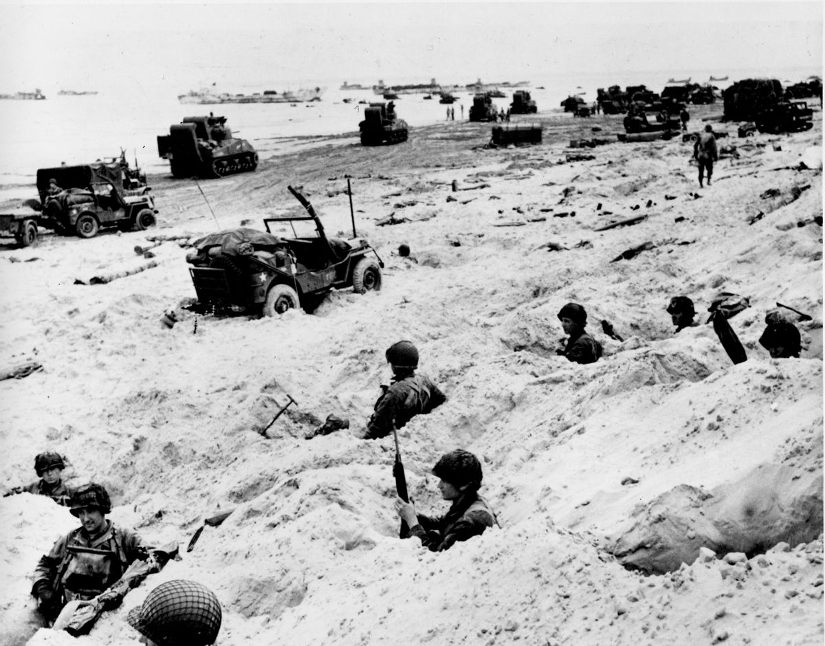 This June 6, 1944, file photo shows American soldiers of the Allied Expeditionary Force securing a beachhead during initial landing operations at Normandy, France, June 6, 1944.  From the first sketchy German radio broadcast to the distribution of images filmed in color, it has taken decades for the full story of the D-Day invasion to come out. At the time, the reporting, filming and taking of photos was neither easy nor straightforward. (AP Photo/Weston Haynes, File) (AP)