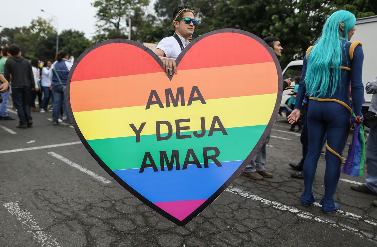 """A man carries a heart that reads in Spanish """"Love and let love"""" at a gay pride parade in Lima, Peru, Saturday, June 28, 2014. Gays, lesbians and transgenders are holding gay pride parades worldwide this month as part of annual demonstrations demanding equal rights and to protest discrimination. (AP Photo/Sebastian Castaneda) (AP)"""