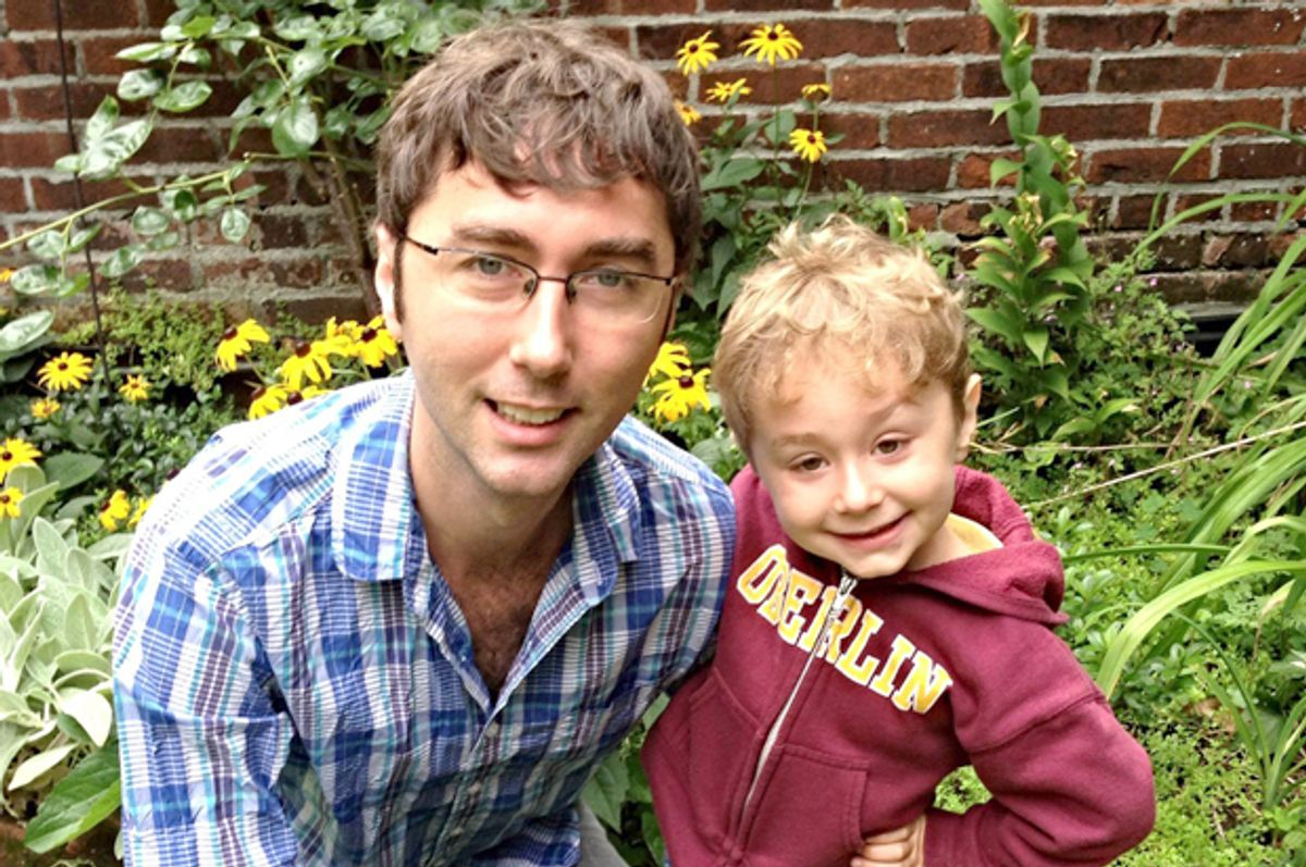 A photo of the author with his son.