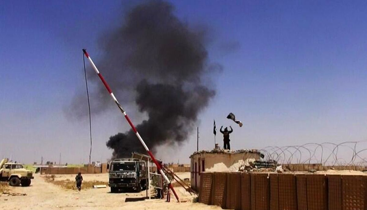 Militants from the al-Qaida-inspired Islamic State of Iraq and the Levant (ISIL) people raising their flag at the entrance of an army base in Ninevah Province. Iraq.  (AP)