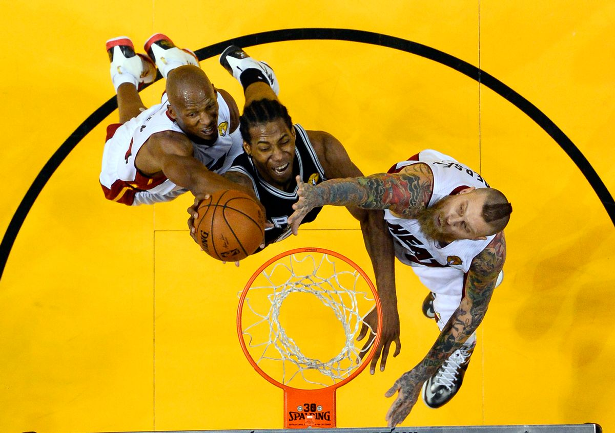 Miami Heat guard Ray Allen, left, and forward Chris Andersen block a shot by San Antonio Spurs forward Kawhi Leonard, center, in the second half in Game 3 of the NBA basketball finals in Miami, Tuesday, June 10, 2014. The Spurs won 111-92. (AP Photo/Larry W. Smith, Pool) (AP)