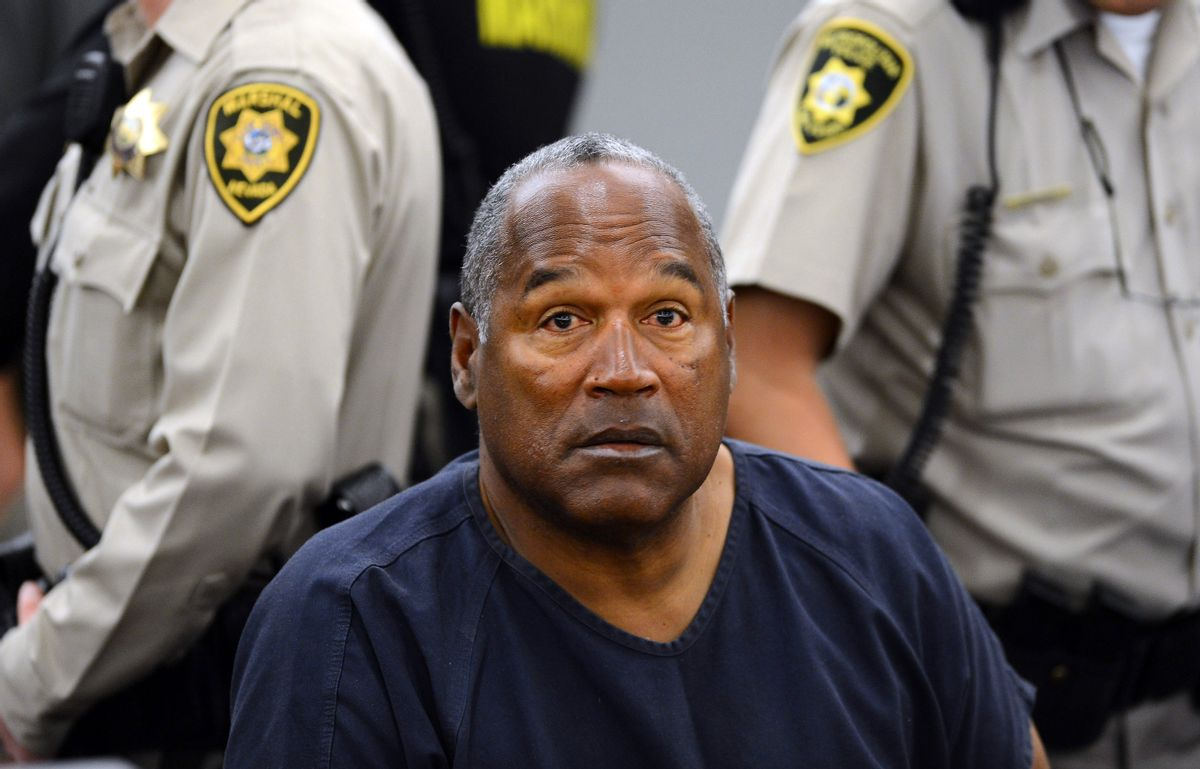 FILE - In this May 14, 2013 file photo, O.J. Simpson sits during a break on the second day of an evidentiary hearing in Clark County District Court in Las Vegas. Simpson is serving nine to 33 years in prison for his 2008 conviction in the armed robbery of two sports memorabilia dealers in a Las Vegas hotel room. (AP Photo/Ethan Miller, Pool, File) (AP)