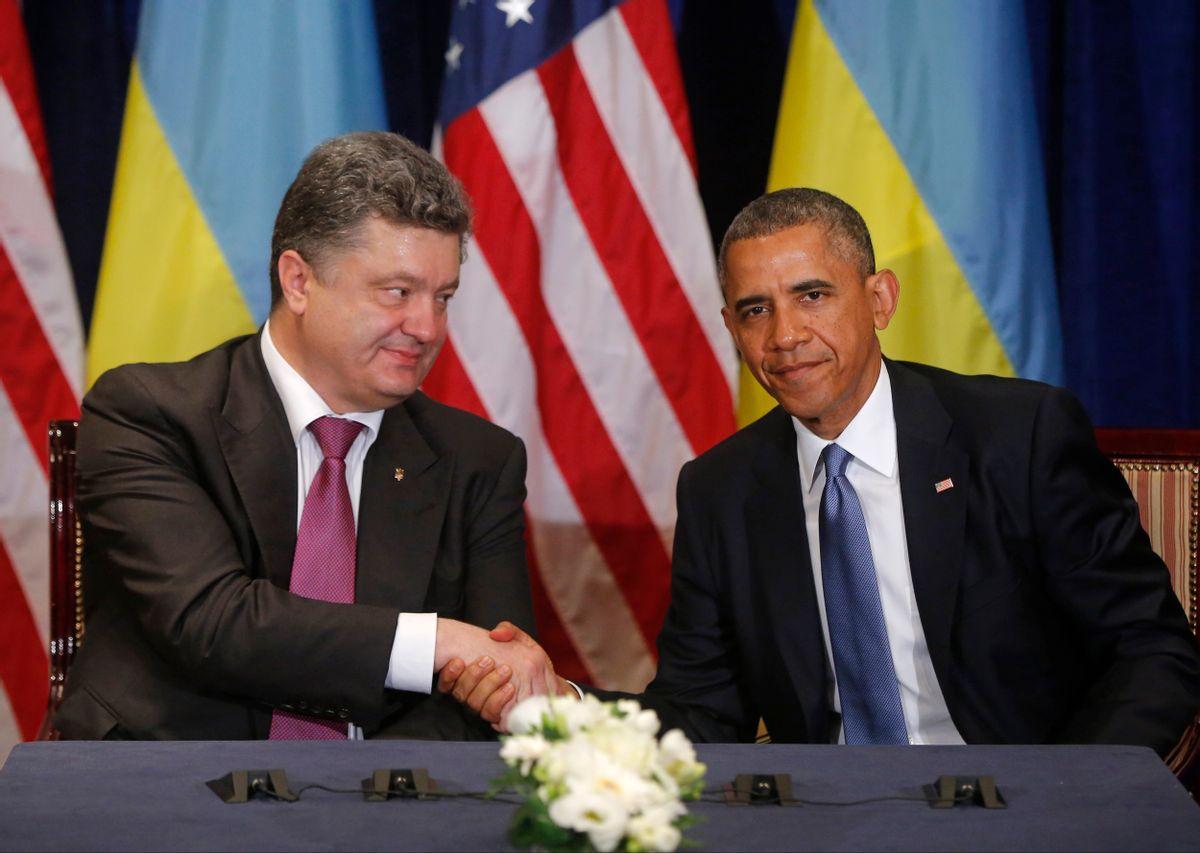 U.S. President Barack Obama, right, shakes hands with Ukraine president-elect Petro Poroshenko in Warsaw, Poland, Wednesday, June 4, 2014. (AP Photo/Charles Dharapak) (AP)