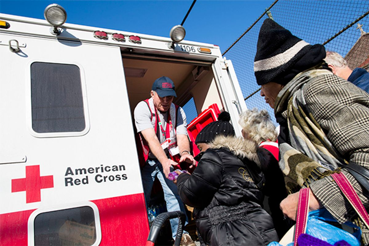 A member of the Red Cross distributes food to residents of Coney Island affected by Superstorm Sandy, Nov. 9, 2012.     (AP/John Minchillo)