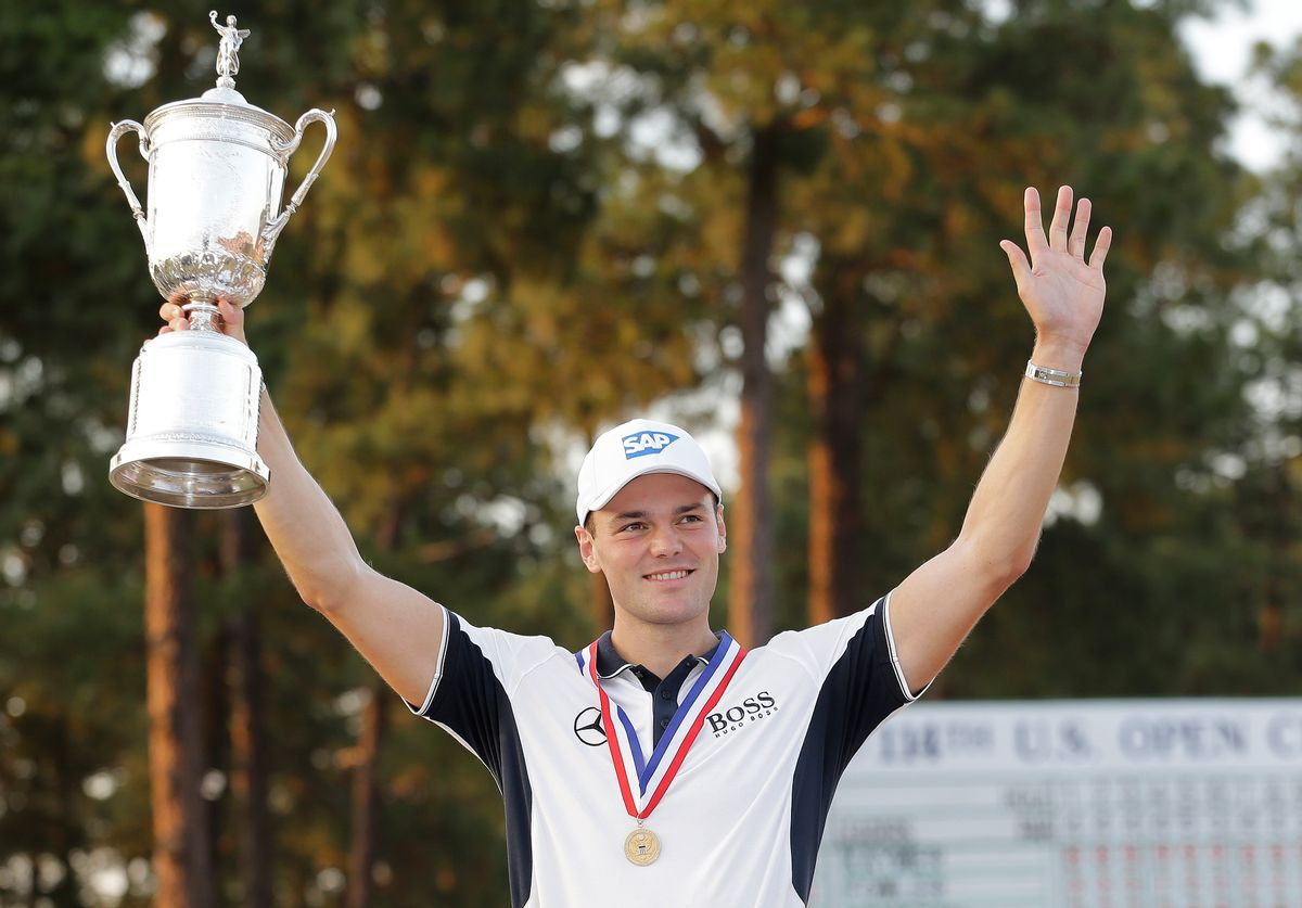 Martin Kaymer, of Germany, holds up the trophy after wining the U.S. Open golf tournament in Pinehurst, N.C., Sunday, June 15, 2014.  (AP Photo/Eric Gay) (Eric Gay)