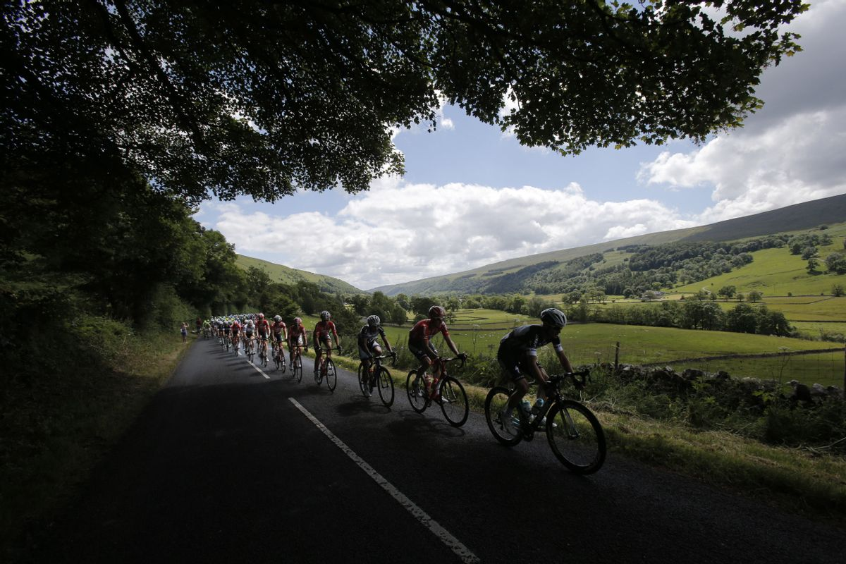 10ThingstoSeeSports - The pack rides through the rolling hills of Yorkshire during the first stage of the Tour de France cycling race over 190.5 kilometers (118.4 miles) with start in Leeds and finish in Harrogate, England, Saturday, July 5, 2014. (AP Photo/Christophe Ena, File) (AP)