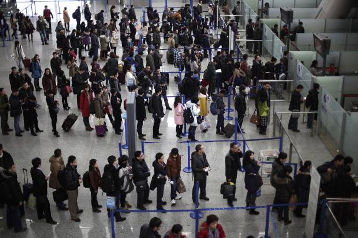 Airport  (AP Photo/Eugene Hoshiko)