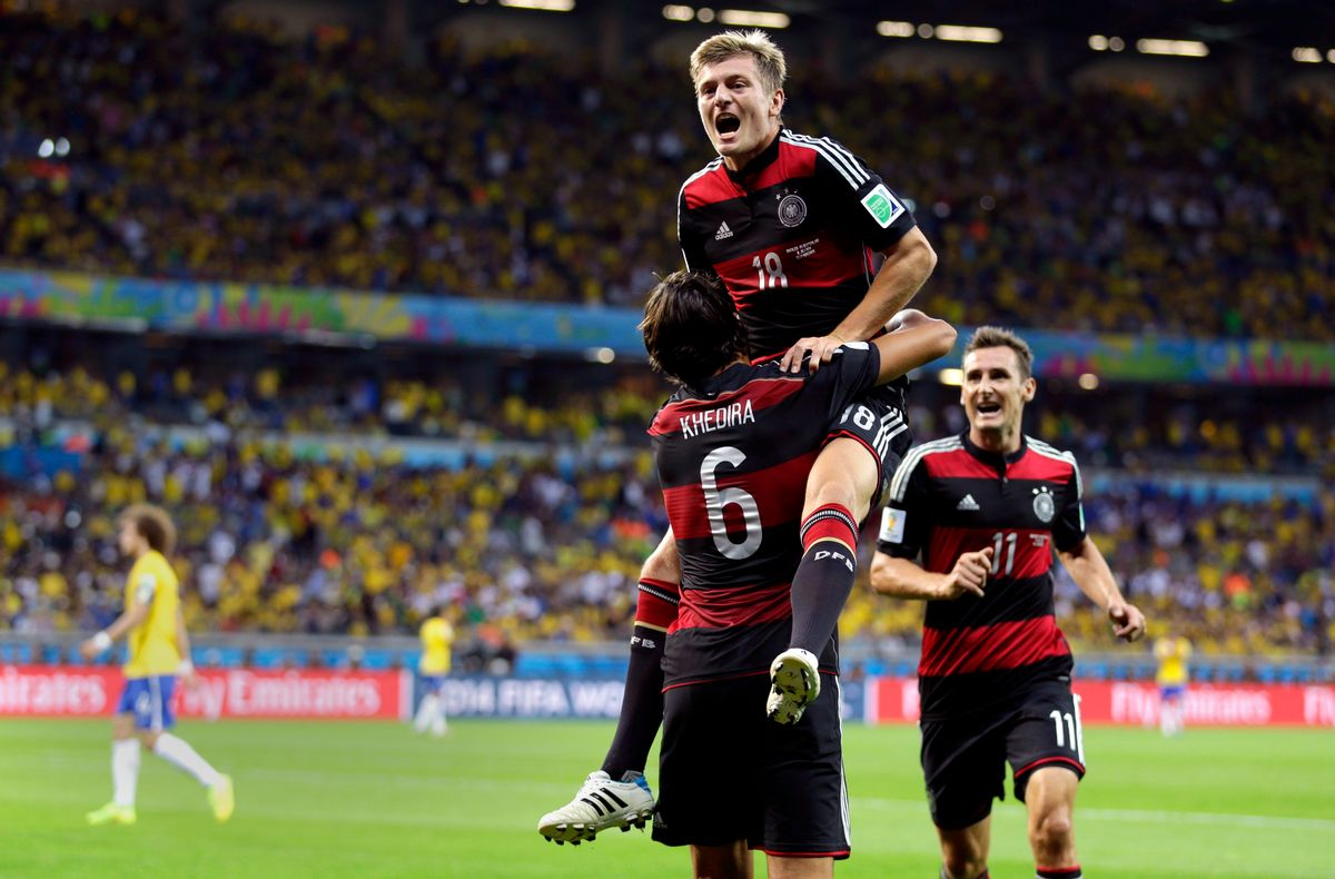Germany's Toni Kroos celebrates with Sami Khedira (6) and Miroslav Klose (11) after scoring his side's fourth goal during the World Cup semifinal soccer match between Brazil and Germany at the Mineirao Stadium in Belo Horizonte, Brazil, Tuesday, July 8, 2014. (AP Photo/Natacha Pisarenko) (Natacha Pisarenko)