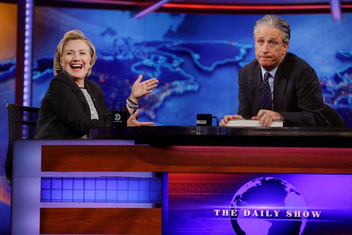 """Former U.S. Secretary of State Hillary Rodham Clinton reacts to host Jon Stewart during a taping of """"The Daily Show with Jon Stewart,"""" Tuesday, July 15, 2014, in New York.  (AP Photo/Frank Franklin II) (AP)"""