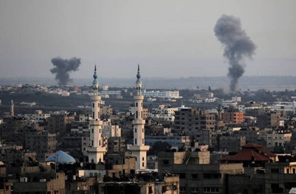 Columns of smoke rise following Israeli strikes on Gaza Strip, Saturday, July 12, 2014. Israeli airstrikes on Gaza hit a mosque and a center for the disabled where a few women were killed Saturday, raising the Palestinian death toll from the offensive to more than 130, Palestinian officials said, in an offensive that showed no signs of slowing down  (AP Photo/Adel Hana)