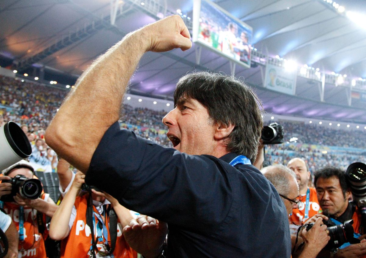 Germany's head coach Joachim Loew acknowledges the cheers during a victory lap after the World Cup final soccer match between Germany and Argentina at the Maracana Stadium in Rio de Janeiro, Brazil, Sunday, July 13, 2014. Germany won the match 1-0. (AP Photo/Matthias Schrader)  (Matthias Schrader)