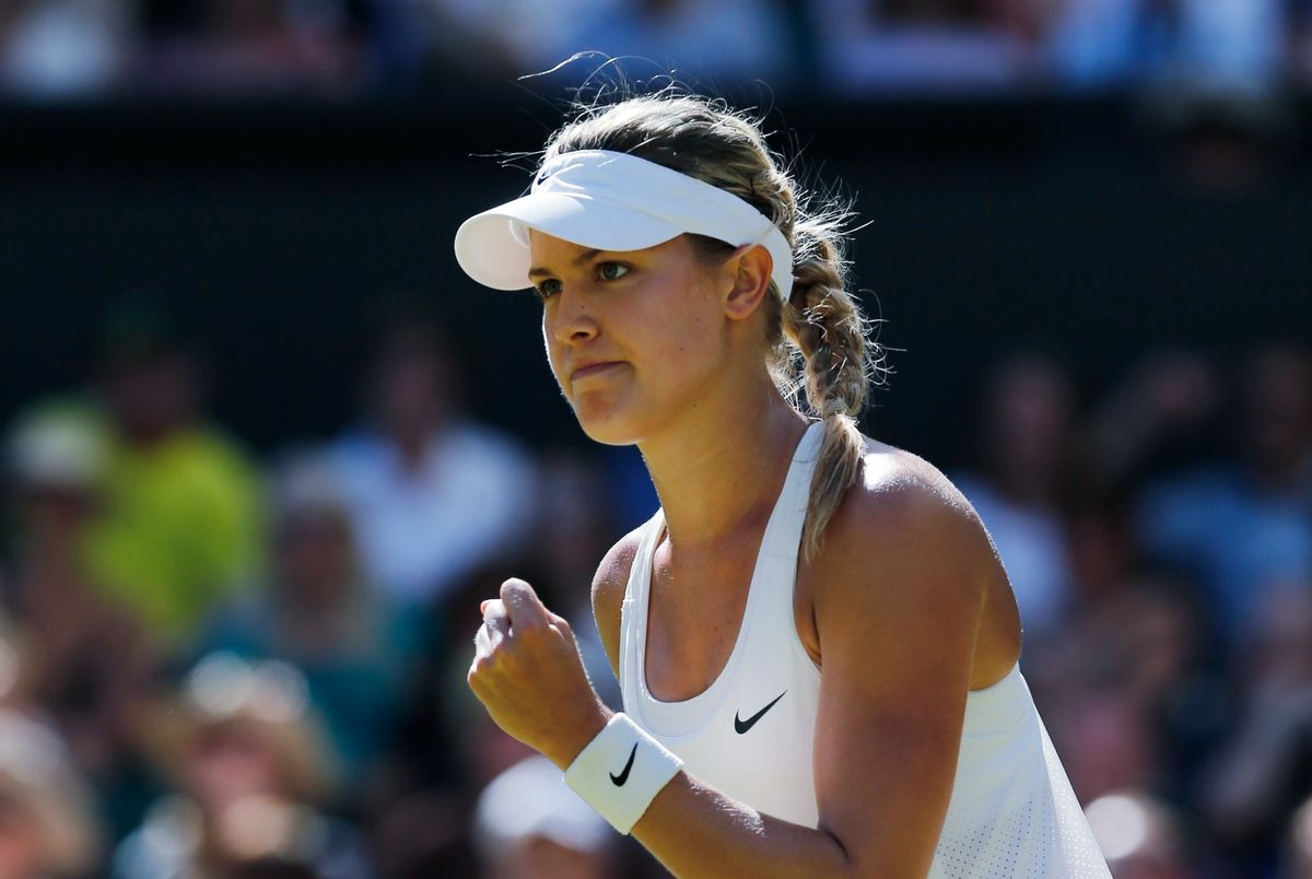 Eugenie Bouchard of Canada celebrates after winning the first set as she plays against Simona Halep of Romania during their women's singles semifinal match at the All England Lawn Tennis Championships in Wimbledon, London, Thursday, July 3, 2014. (AP Photo/Ben Curtis) (Ben Curtis)