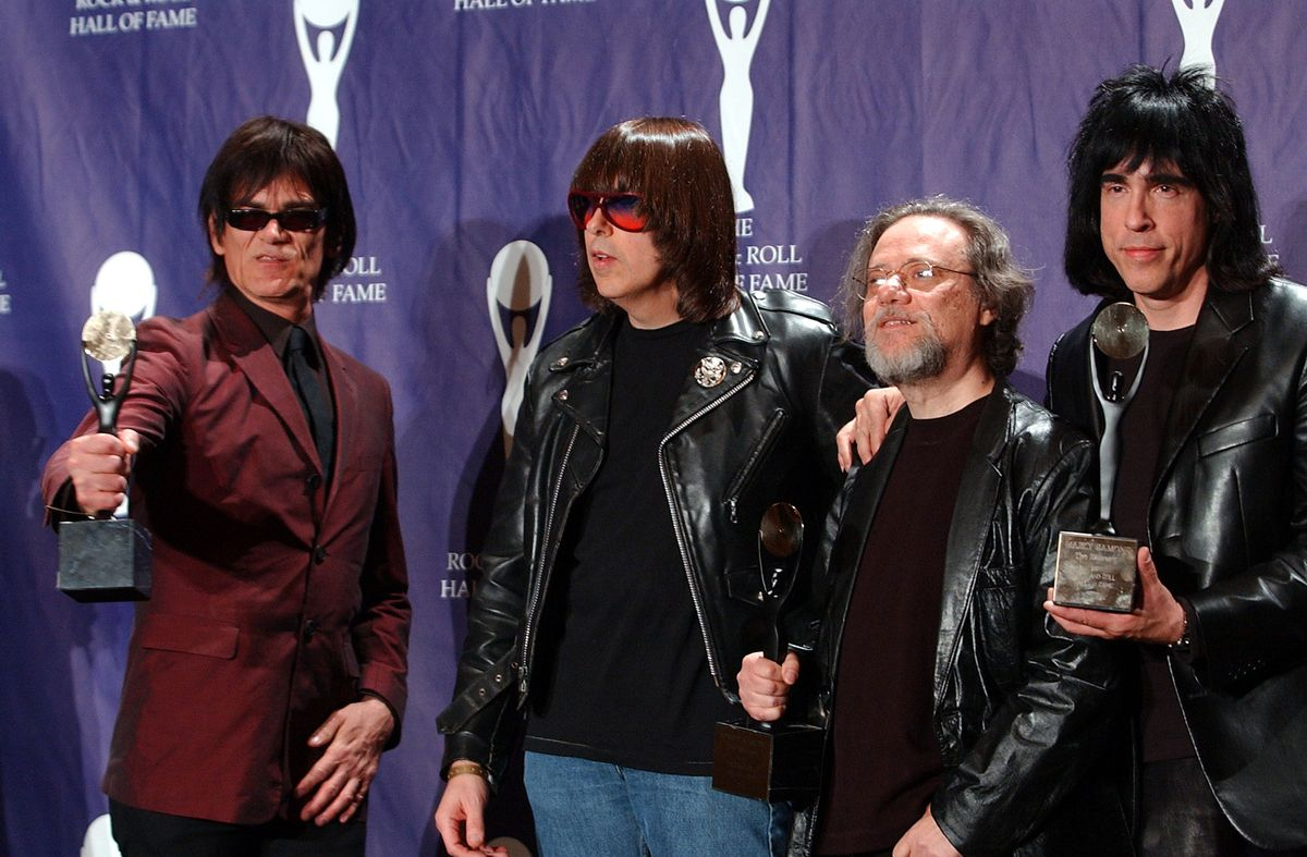 CORRECTS AGE TO 65 AND REMOVES REFERENCE TO WIFE - FILE - In this March 18, 2002, file photo, members of the Ramones, from left to right, Dee Dee, Johnny, Tommy and Marky Ramone hold their awards after being inducted at the Rock and Roll Hall of Fame induction ceremony at New York's Waldorf Astoria. A business associate says Tommy, the last surviving member of the original group, has died. Dave Frey, who works for Ramones Productions and Silent Partner Management, confirmed that he died on Friday, July 11, 2014. Ramone was 65. (AP Photo/Ed Betz, File) (AP)
