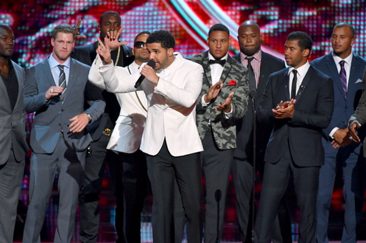 Drake, center, and the Seattle Seahawks at the ESPY Awards at the Nokia Theatre, July 16, 2014, in Los Angeles.    (AP/John Shearer)