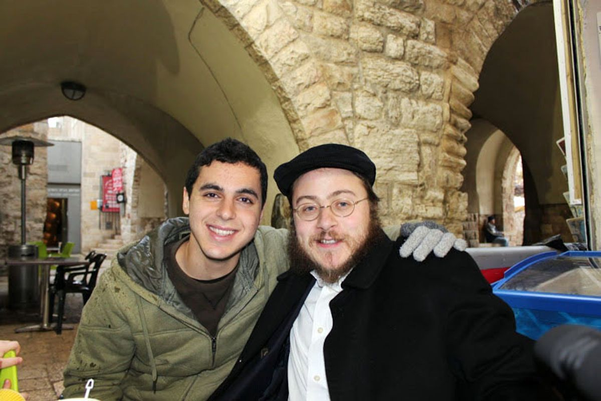 This 2012 photo provided by Rabbi Asher Hecht, shows Nissim Sean Carmeli, left, with Hecht in Jerusalem. The Israel Defense Forces said Sunday, July 20, 2014, in a statement that Carmeli was killed in combat in the Gaza Strip. Carmeli was from South Padre Island, Texas, said Deputy Consul General of Israel to the Southwest Maya Kadosh. (AP Photo/Rabbi Asher Hecht via Chabad of the Rio Grande Valley)  (AP)