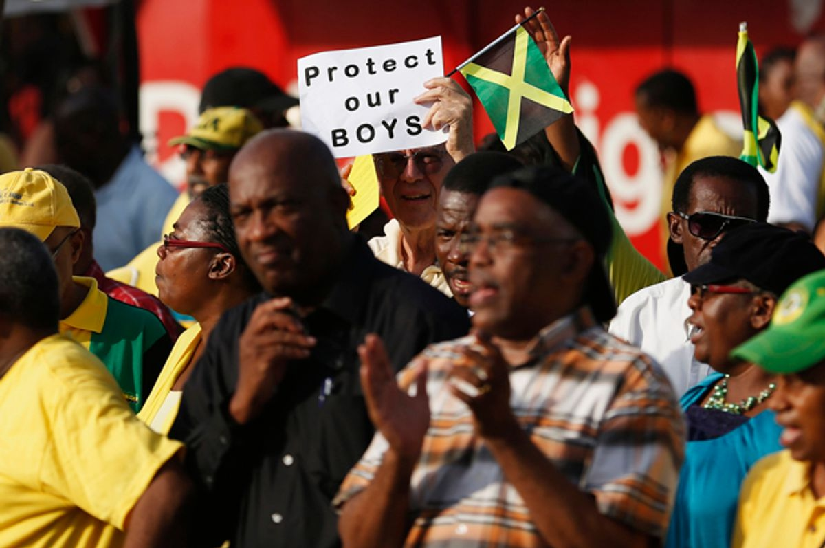 Thousands of Jamaicans hold a demonstration against the local LGBT community in Half Way Tree, Kingston, June 29, 2014.        (Reuters/Gilbert Bellamy)