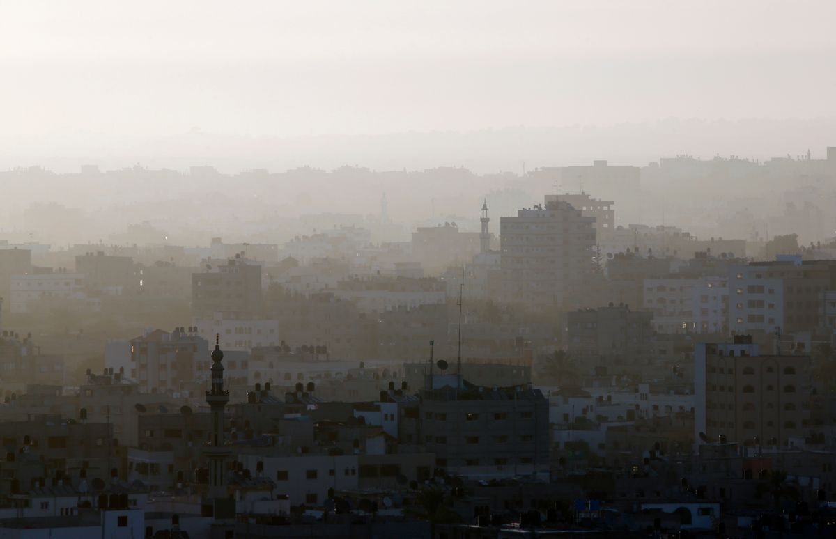 A hazy Gaza City is seeen in northern Gaza strip early Friday, July 18, 2014. The heavy thud of tank shells, often just seconds apart, echoed across the Gaza Strip early Friday as thousands of Israeli soldiers launched a ground invasion, escalating a 10-day campaign of heavy air bombardments to try to destroy Hamas' rocket-firing abilities and the tunnels militants use to infiltrate Israel. (AP Photo/Lefteris Pitarakis)  (AP)