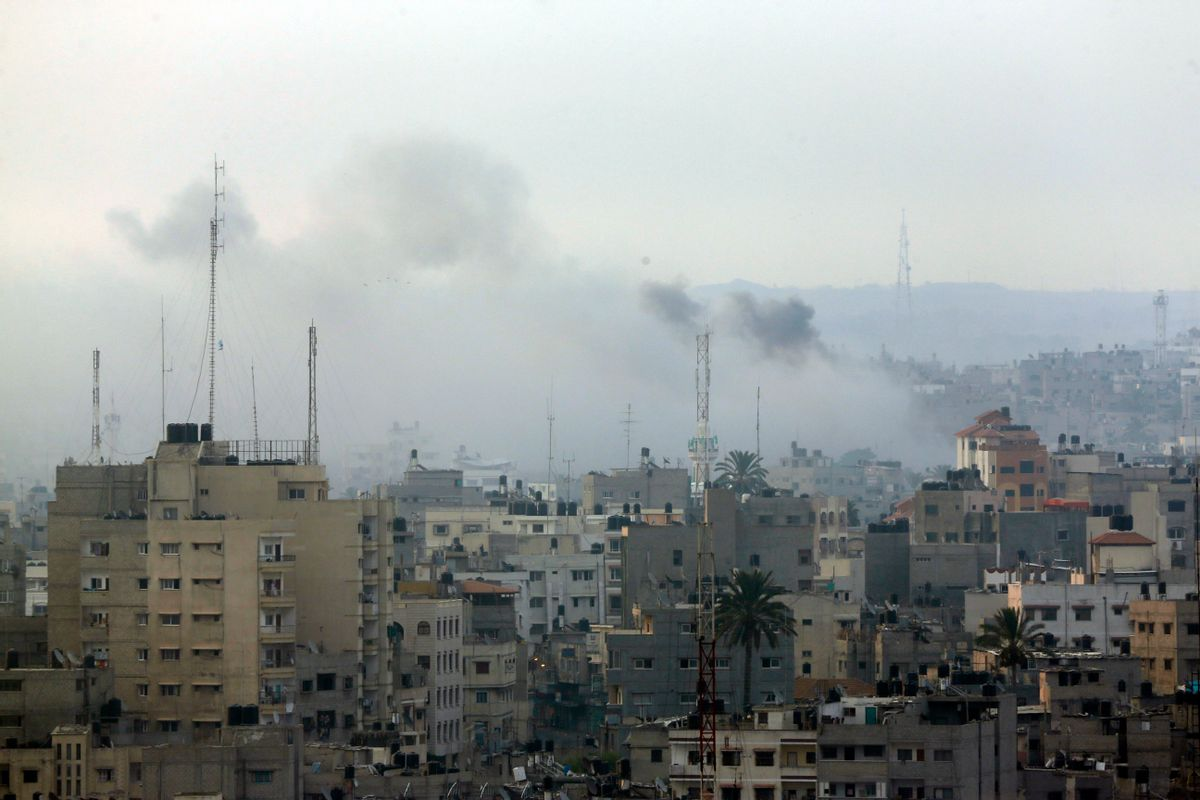 Smoke from Israeli strikes rises over Gaza City , northern Gaza Strip, Sunday, July 20, 2014. Israel said it widened its ground offensive early Sunday, sending more troops into Gaza after demolishing more than a dozen Hamas tunnels and intensifying tank fire on border areas. Since the start of Israel-Hamas fighting almost two weeks ago, over 300 Palestinians were killed and 2,700 wounded in Israeli air and artillery strikes, according to Palestinian health officials. One-fourth of the deaths were reported since the start of the ground offensive late Thursday, the officials said.(AP Photo/Lefteris Pitarakis)  (AP)