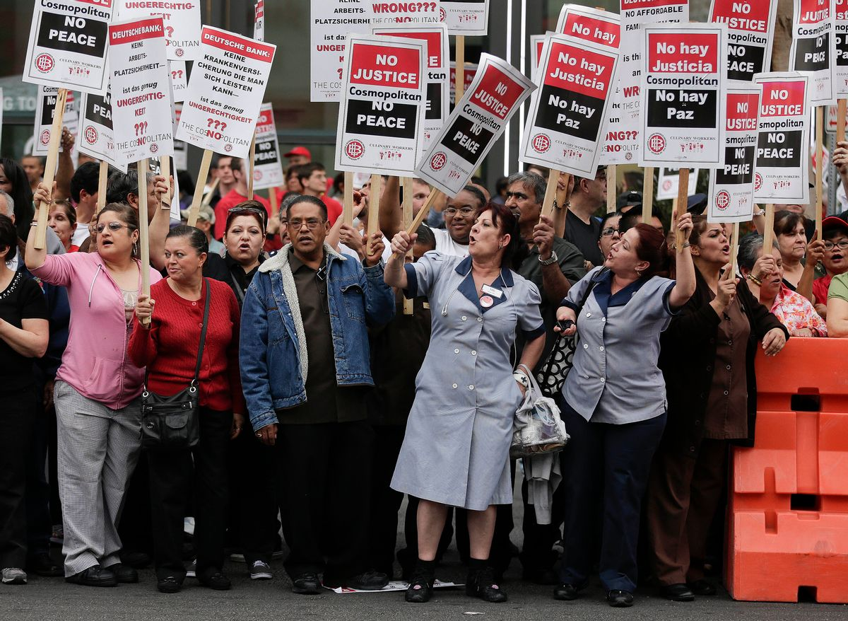 FILE - This March 20, 2013, file photo shows Culinary Union workers demonstrating along Las Vegas Boulevard, protesting against their contract negotiations with Deutsche Bank in Las Vegas.  (AP Photo/Julie Jacobson, File)
