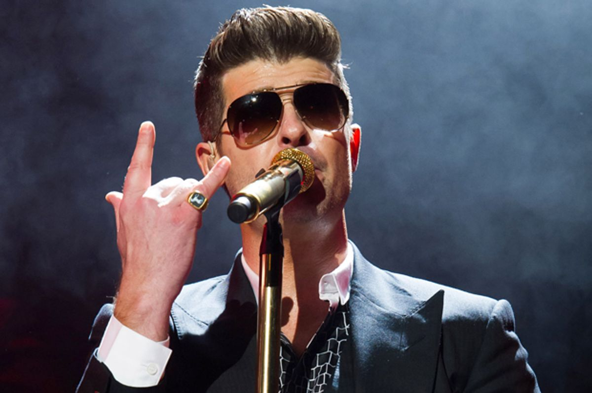 Robin Thicke performs in concert on Friday, March 7, 2014 in New York. (Photo by Charles Sykes/Invision/AP)   (Charles Sykes)
