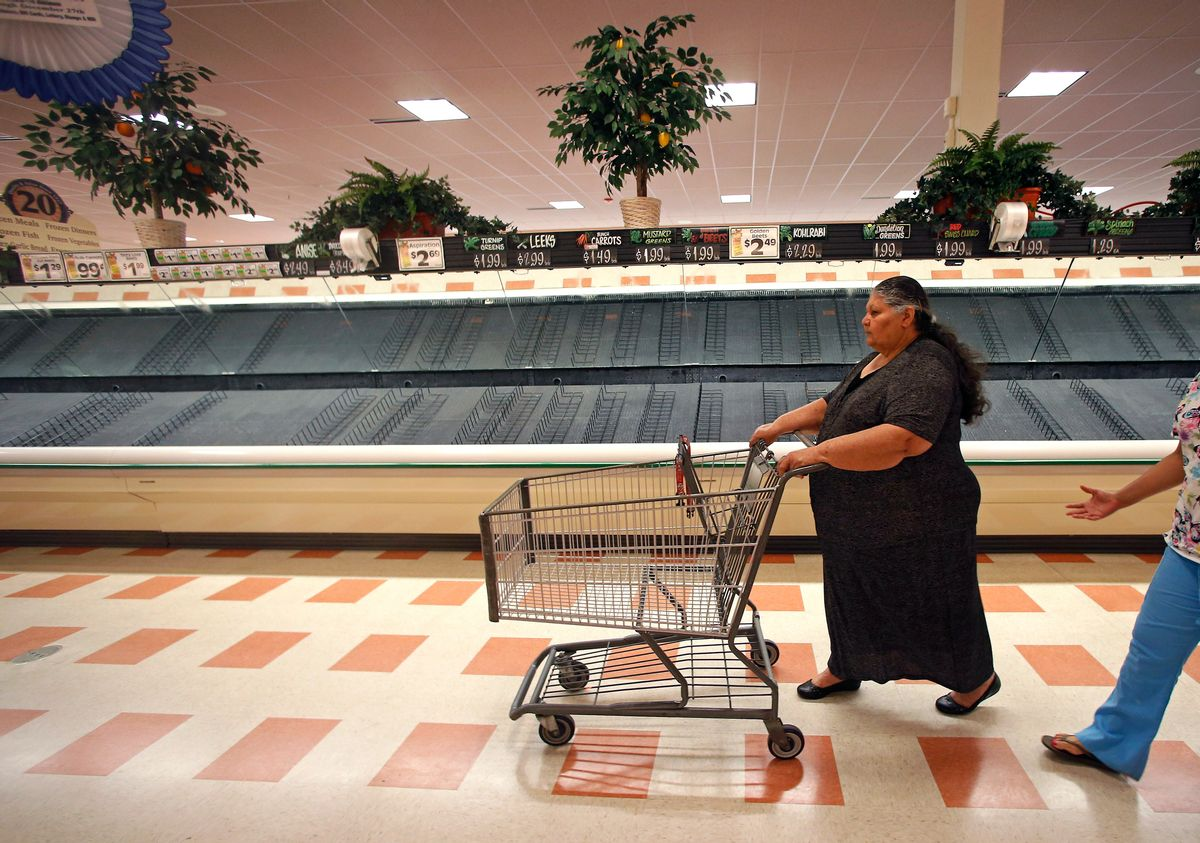 Maria Arvarado, of Haverhill, Mass. finds empty produce bins as she shops Thursday, July 24, 2014 at Market Basket supermarket in Haverhill, Mass. A decades-long family feud, which brought about the ouster of Arthur T. Demoulas as CEO of the privately held company, led to a worker revolt, customer boycotts and empty shelves in the grocery chain's stores in Maine, Massachusetts and New Hampshire. More than 100 Massachusetts legislators and mayors, Massachusetts Attorney General Martha Coakley, and New Hampshire Gov. Maggie Hassan have publicly supported the employees. (AP Photo) (AP)