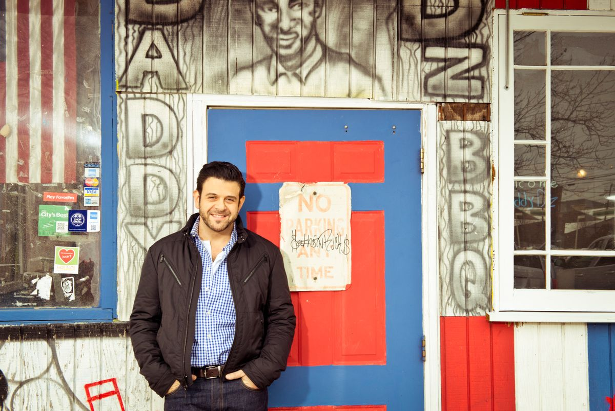"""This undated photo provided by the Travel Channel shows host Adam Richman of the new series, """"Man Finds Food"""" in Atlanta.  The channel said Tuesday, July 1, 2014, that Richman's show has been postponed indefinitely but didn't explain why. """"Man Finds Food"""" was to debut Wednesday. (AP Photo/Travel Channel, Gabriela Herman)  (AP)"""