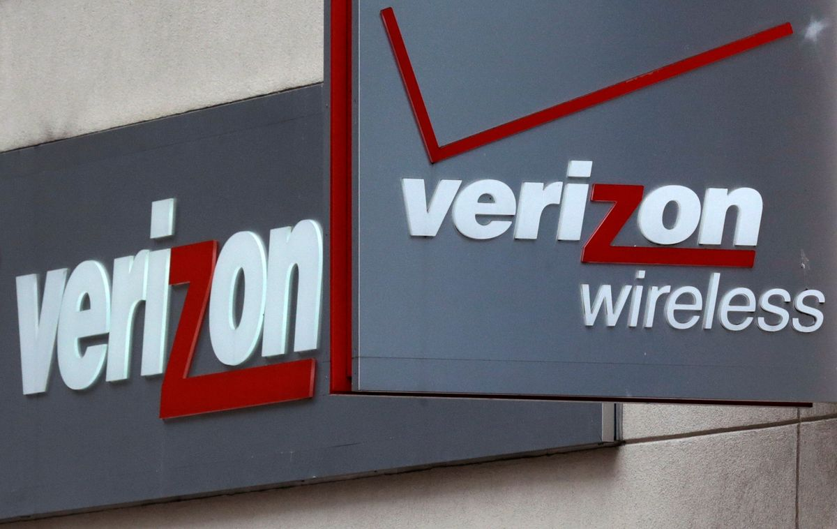 This June 4, 2014 photo shows signage at a Verizon Wireless retail store at Downtown Crossing in Boston. (AP/Charles Krupa)