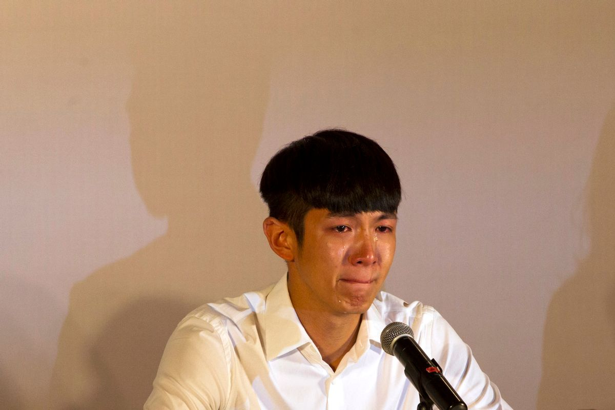 Kai Ko cries during a press conference held after his release from detention in Beijing, China, Friday, Aug. 29, 2014. Ko, a Taiwanese actor arrested on drug charges along with the son of Hong Kong film star Jackie Chan was released Friday after two weeks in detention, amid a broad anti-drug crackdown in China's capital that has ensnared several celebrities. (AP Photo/Peng Peng) (Peng Peng)