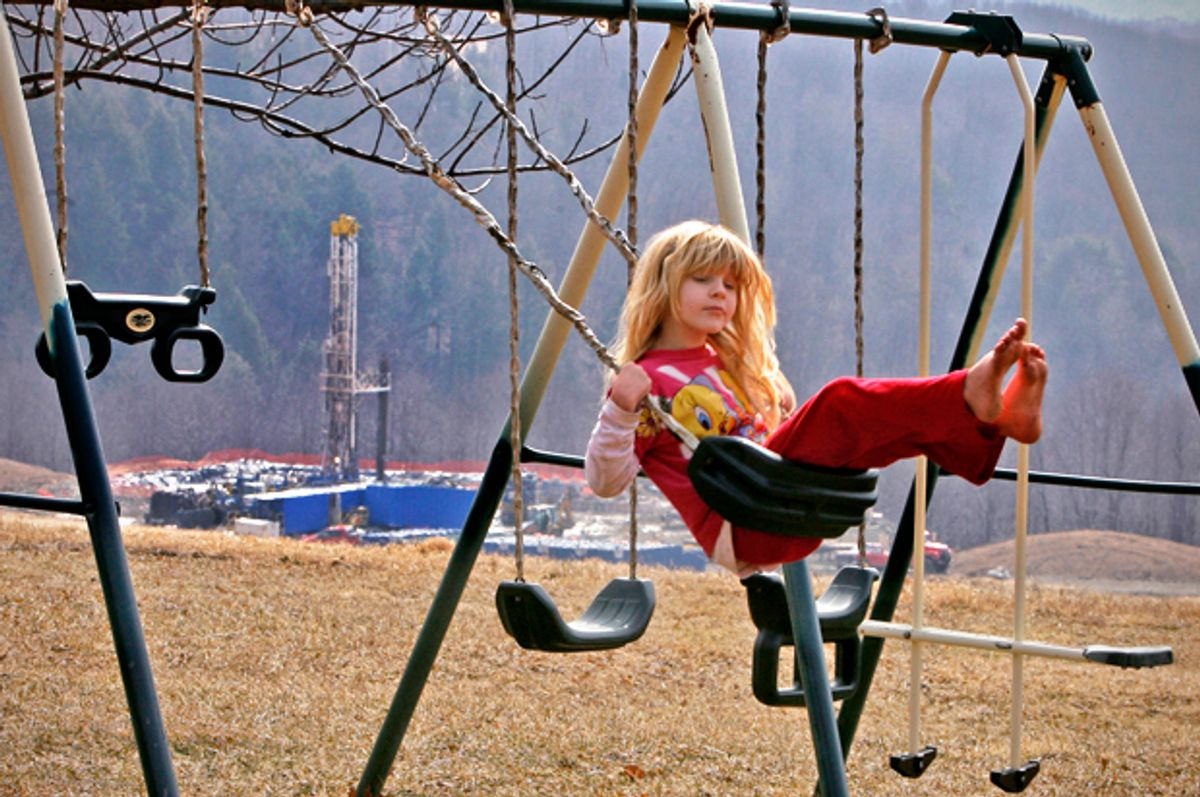 Rachel Farnelli rides on her backyard swing that overlooks the Gesford #3 natural gas well in Dimock, Pennsylvania, March 7, 2009.       (Reuters/Tim Shaffer)
