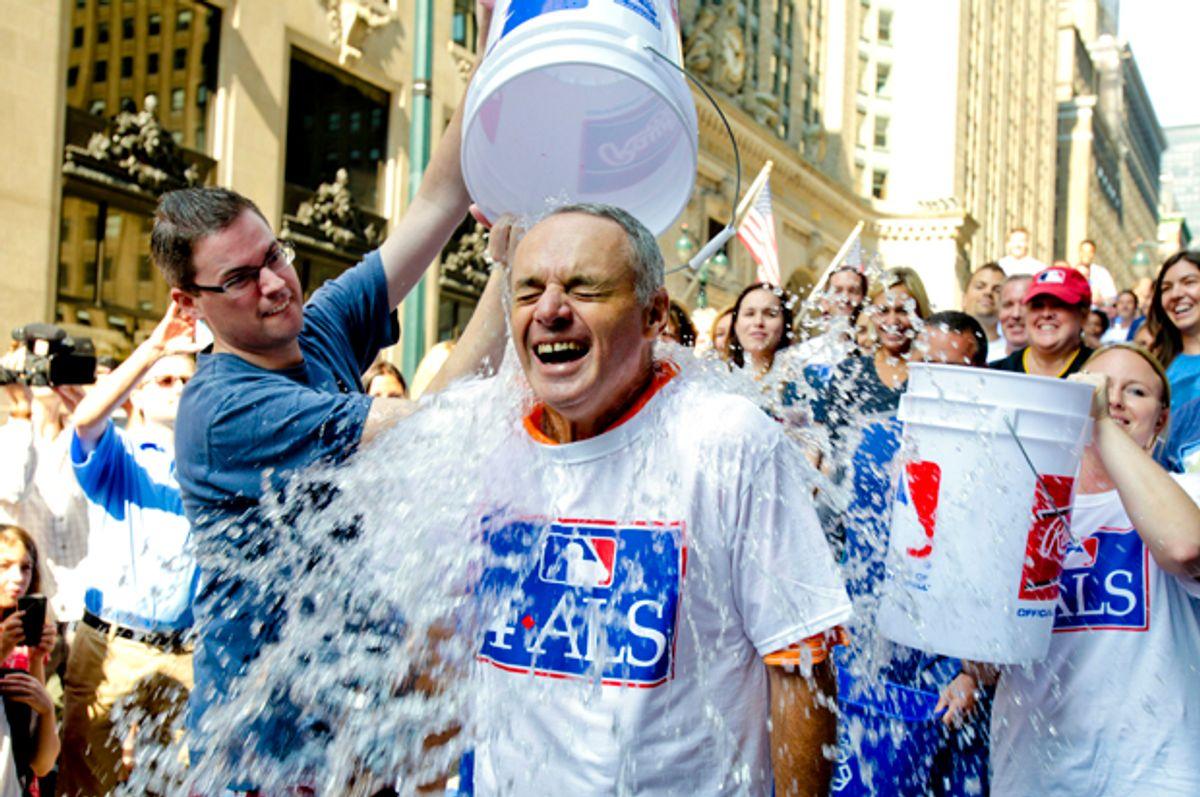 Major League Baseball Commissioner-elect Rob Manfred participates in the ALS Ice-Bucket Challenge, Aug. 20, 2014.       (AP/Vanessa A. Alvarez)