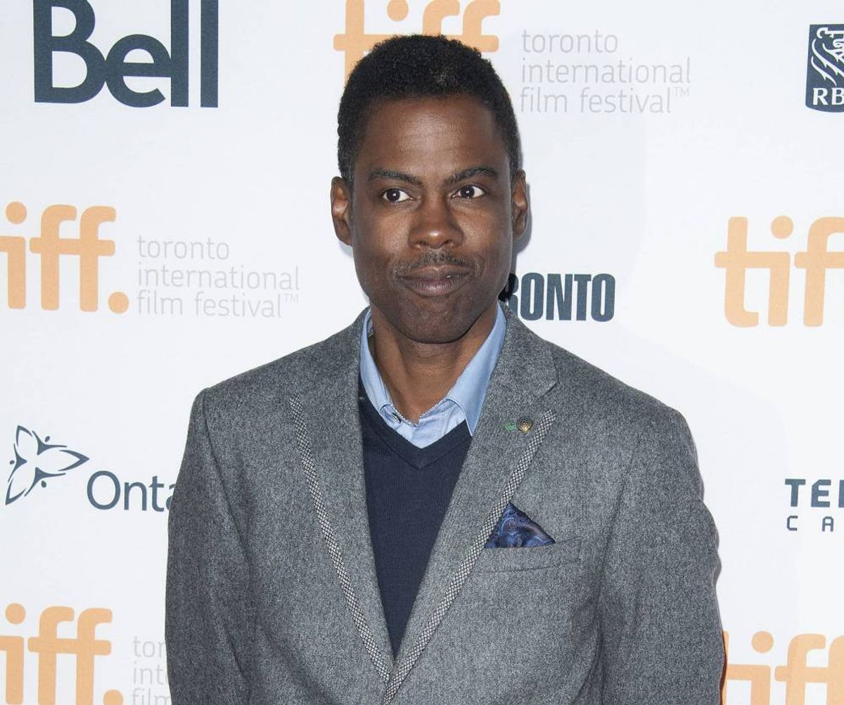 """Chris Rock poses at the """"Top Five"""" premiere at the Princess of Wales Theatre during the 2014 Toronto International Film Festival on Saturday, Sept. 6, 2014, in Toronto.     (Photo by Arthur Mola/Invision/AP)"""