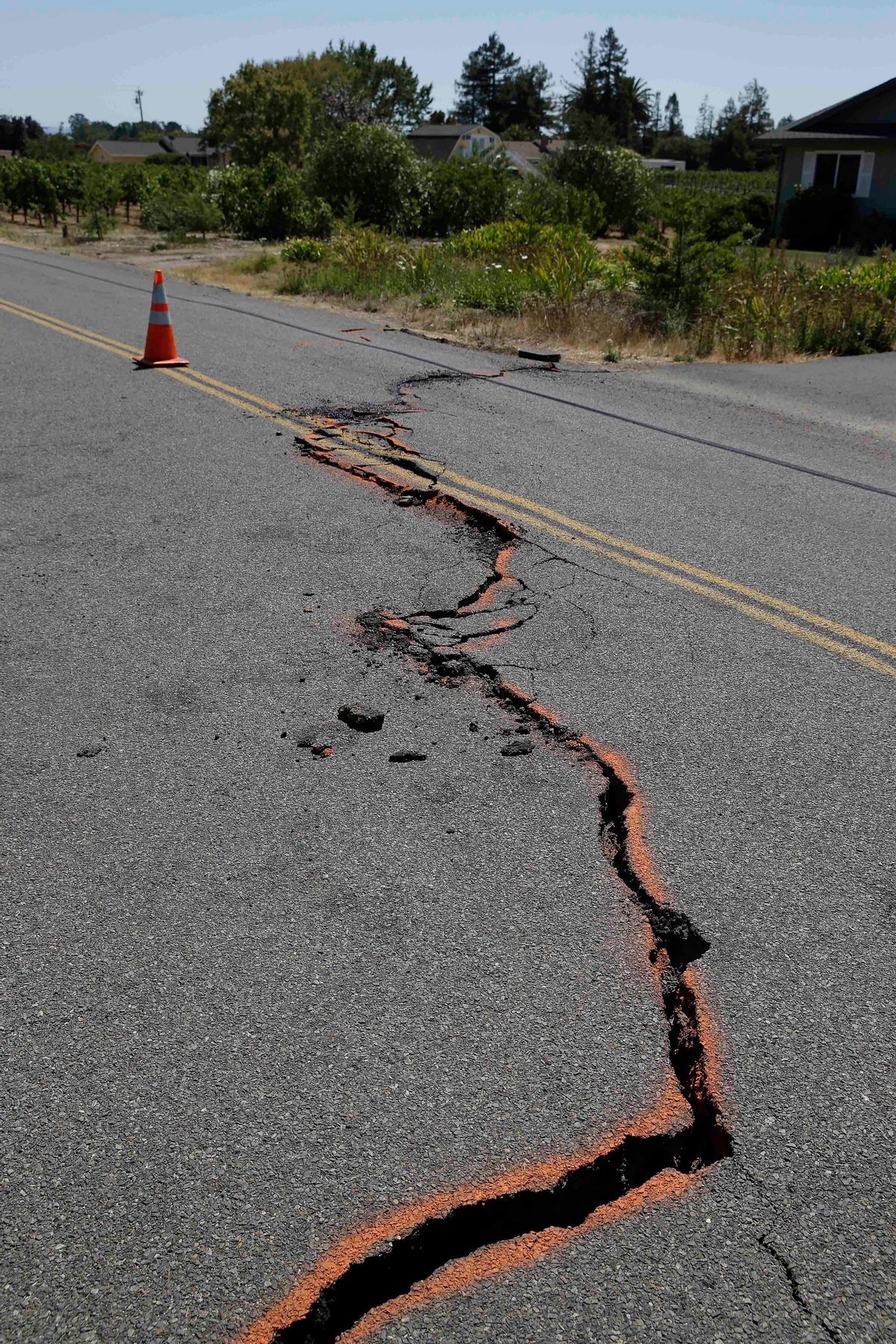 FILE - In this Aug. 24, 2014 file photo, a cracked section of roadway is shown in the Carneros district of Napa, Calif., following an earthquake. Emerging data on last month's Northern California earthquake is explaining why the city of Napa suffered so much of the damage.  (AP Photo/Eric Risberg, File) (AP)