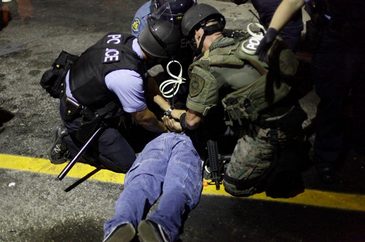Police in riot gear detain a demonstrator in Ferguson, Missouri, Aug. 19, 2014.                (Reuters/Joshua Lott)