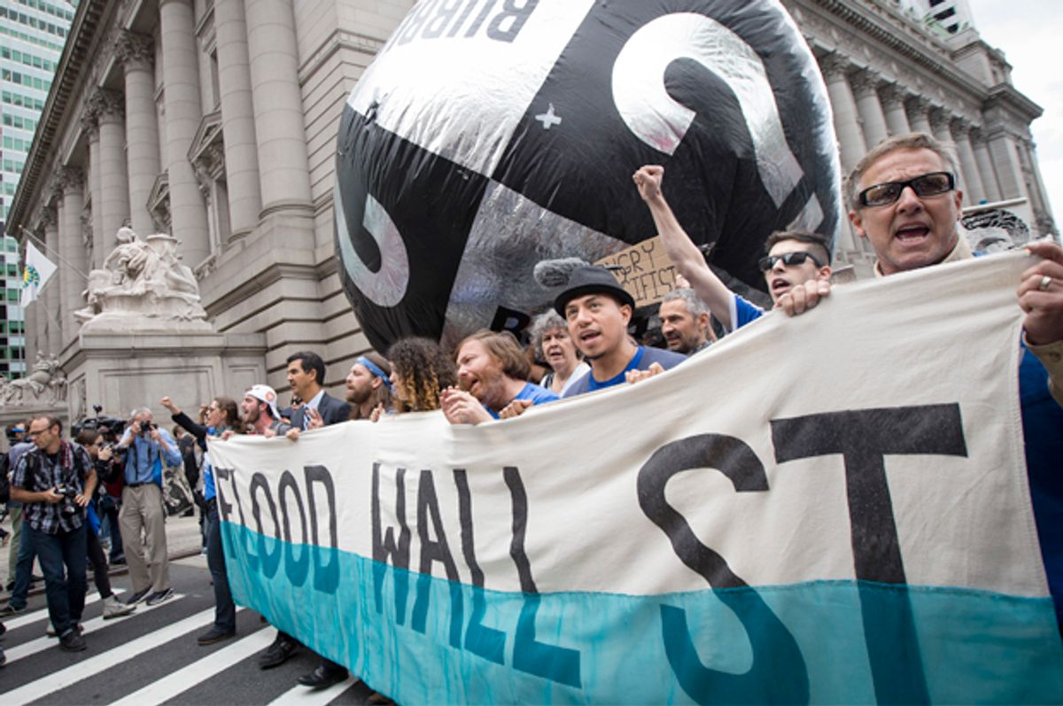 Demonstrators march in New York City to protest for action on climate change, Sept. 22, 2014.            (AP/John Minchillo)