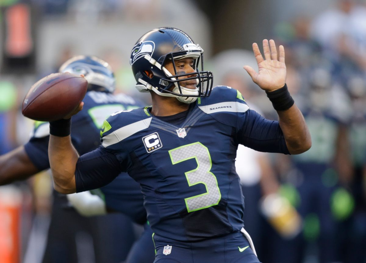 Seattle Seahawks quarterback Russell Wilson winds up to pass against the Green Bay Packers in the first half of an NFL football game, Thursday, Sept. 4, 2014, in Seattle. (AP Photo/Stephen Brashear) (AP)