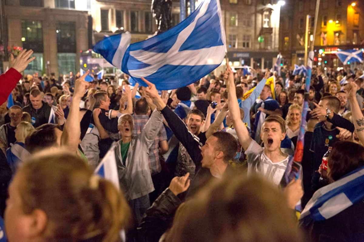 Supporters of the Yes campaign in the Scottish independence referendum in George Square, Glasgow, Scotland, Sept. 18, 2014.     (AP/Matt Dunham)