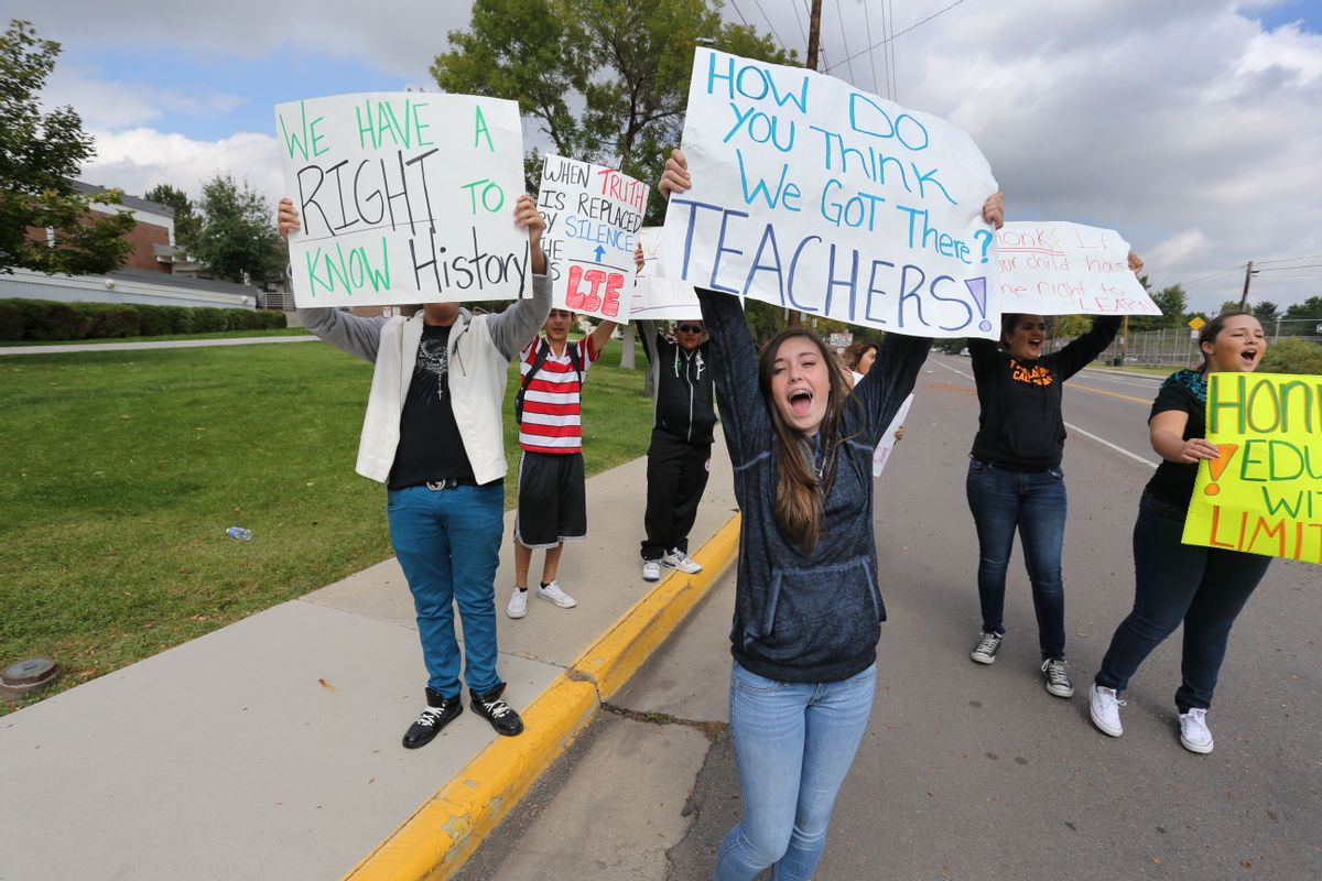 Students protest against a Jefferson County School Board proposal to emphasize patriotism and downplay civil unrest in the teaching of U.S. history, in front of their school, Jefferson High, in the Denver suburb of Edgewater, Monday, Sept. 29, 2014. The Jefferson County School District says classes had to be canceled at Golden and Jefferson high schools on Monday because so many teachers called in sick. (AP/Brennan Linsley)