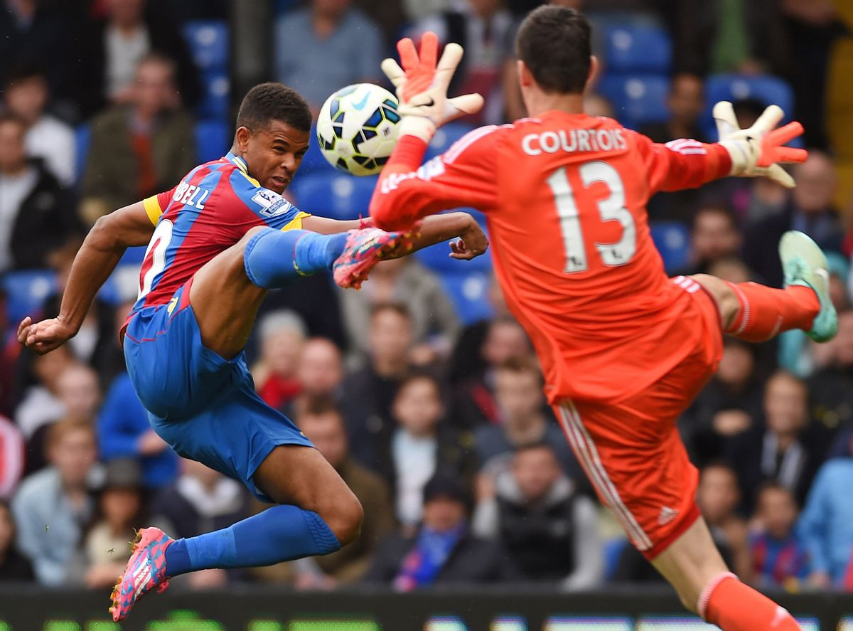 10ThingstoSeeSports - Crystal Palace's Fraizer Campbell, left, competes for the ball with Chelsea's Thibaut Courtois during their English Premier League soccer match at Selhurst Park, London, Saturday, Oct. 18, 2014. (AP Photo/Tim Ireland, File) (AP)