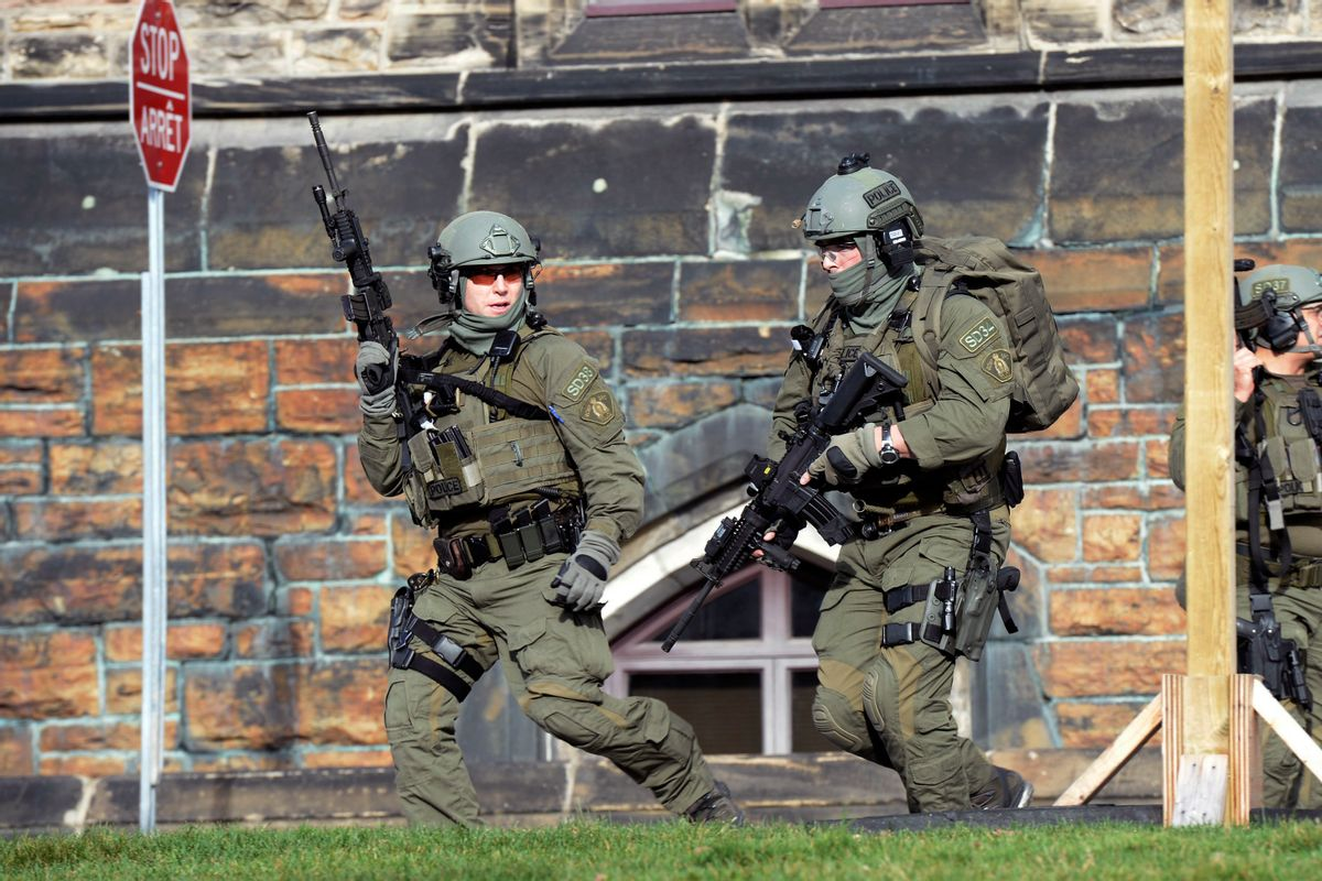 A Royal Canadian Mounted Police intervention team responds to a reported shooting at Parliament building in Ottawa, Wednesday, Oct. 22, 2014. (AP Photo/The Canadian Press, Adrian Wyld)   (AP)