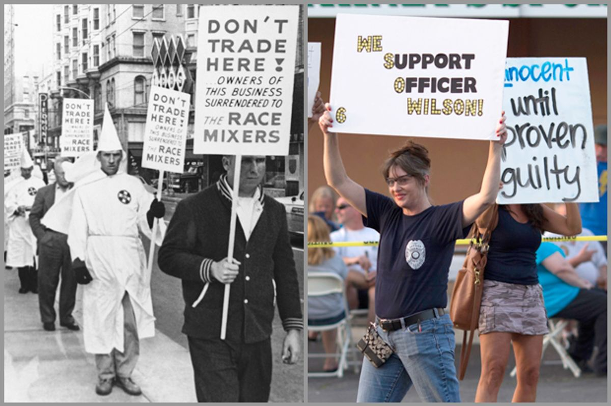Unidentified Ku Klux Klan members are among those picketing a restaurant, July 11, 1964, Atlanta, Ga.; supporters of Darren Wilson hold placards in St. Louis, Mo., Aug. 23, 2014.                   (AP/Reuters/Adrees Latif)