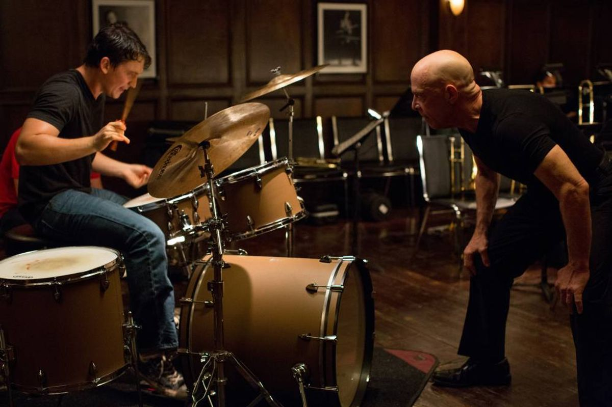 """This image released by Sony Pictures Classics shows Miles Teller, left, and J.K. Simmons in a scene from """"Whiplash."""" (AP Photo/Sony Pictures Classics, Daniel McFadden)"""