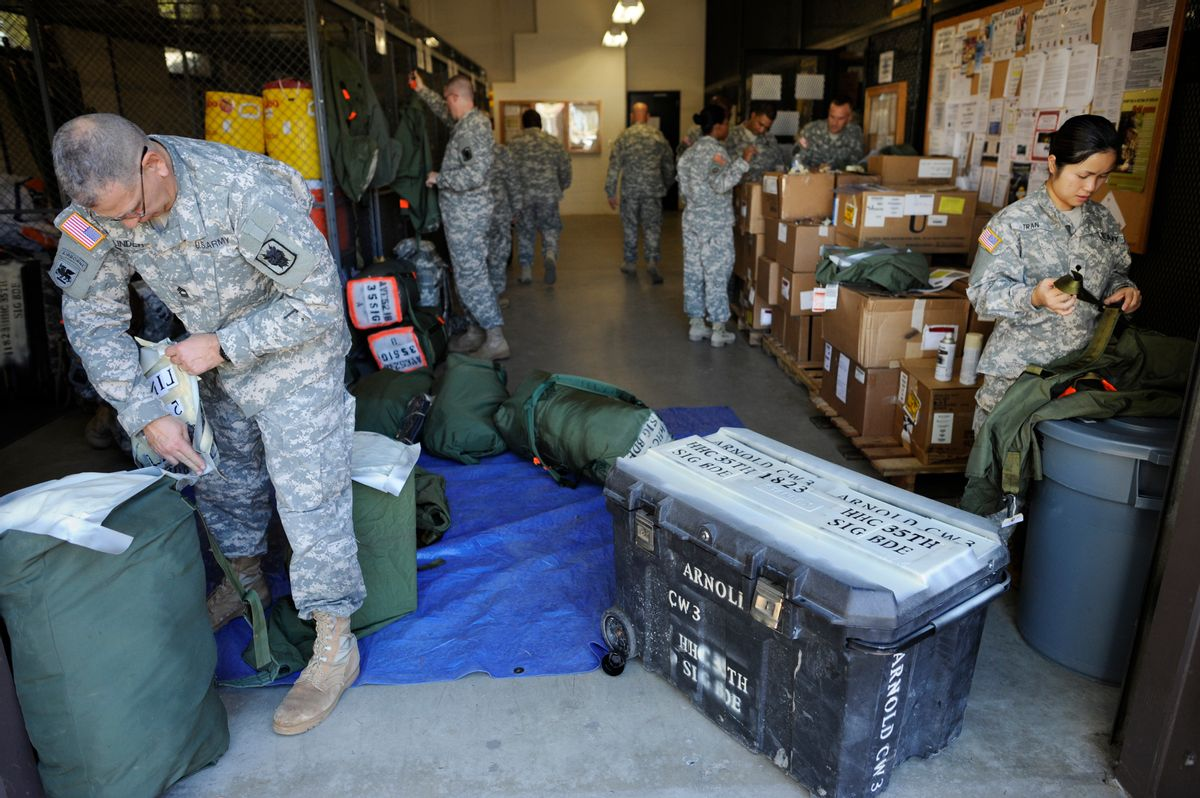 Soldiers from the 35th Theater Tactical Signal Brigade pack their gear as they prepare for deployment to west Africa to aid against the spread of the Ebola virus in Fort Gordon, Ga., Monday, Oct. 20, 2014. (AP Photo/The Augusta Chronicle, Michael Holahan) (AP)